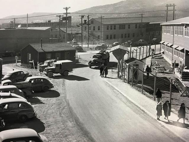 town with cars and people in 1945-1955