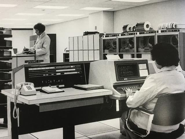 people working in an office in the 1970s