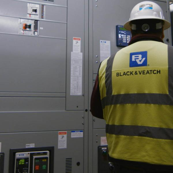 Black and Veatch worker in front of control panels